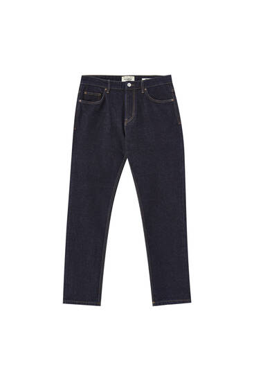 Regular blue jeans with distressed detail