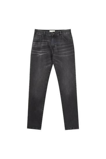 Jeans skinny elásticos negro deslavado