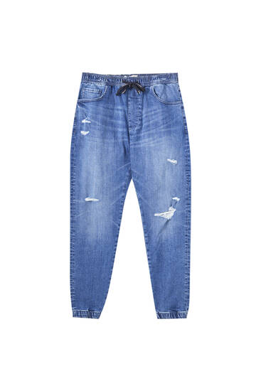 Jeans in joggingmodel met scheuren en zakken