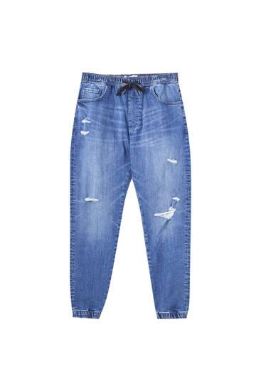 Jeans jogger bolsillos detalle rotos