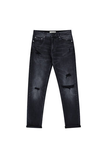 Τζιν παντελόνι slim με λεπτομέρεια από σκισίματα