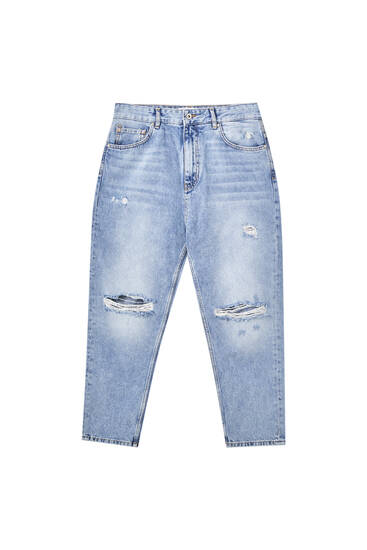 Jeans relaxed fit rotos perneira