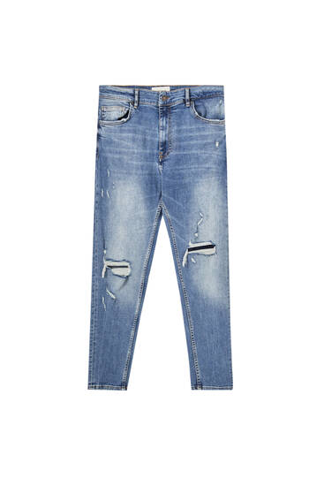 Jeans carrot fit detalle rotos