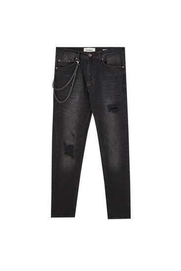 Τζιν παντελόνι skinny fit με σκισίματα και αλυσίδα