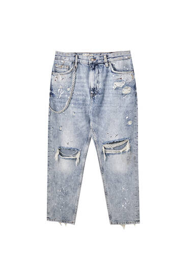 Relaxed fit jeans with rips and paint