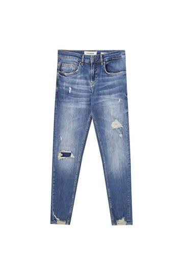 Premium skinny jeans met scheuren op de pijp