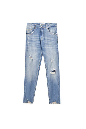 Skinny fit jeans with ripped legs