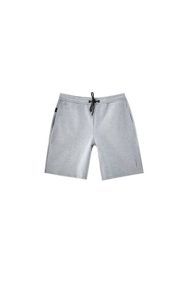 Technical fabric jogger Bermuda shorts - ecologically grown cotton (at least 50%)