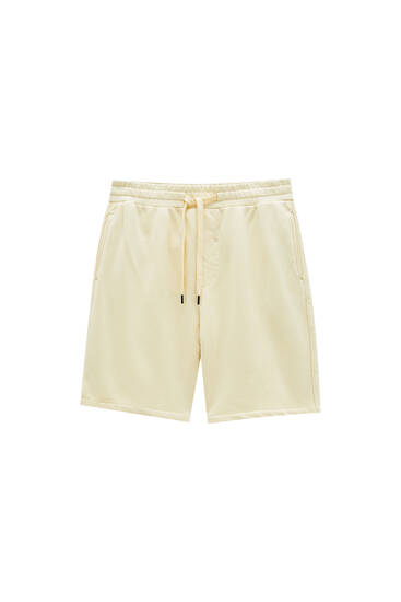 Garment-dyed jogger Bermuda shorts - Contains recycled cotton