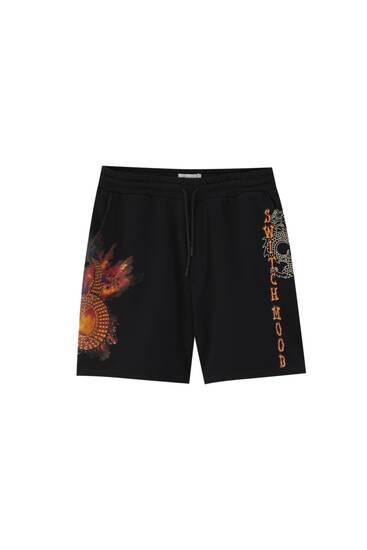 Printed black jogger Bermuda shorts