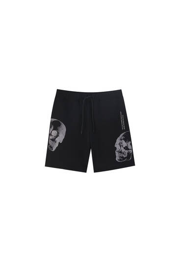 Jogging-style Bermuda shorts with skull print