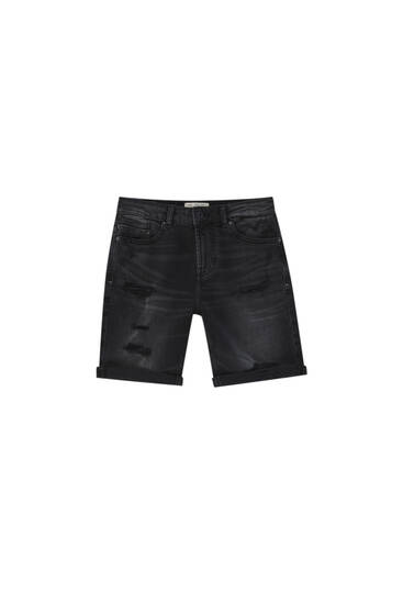 Ripped black denim Bermuda shorts - Contains recycled cotton
