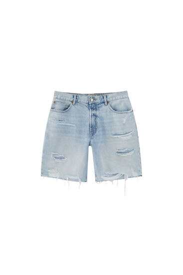 Ripped denim Bermuda shorts with patch