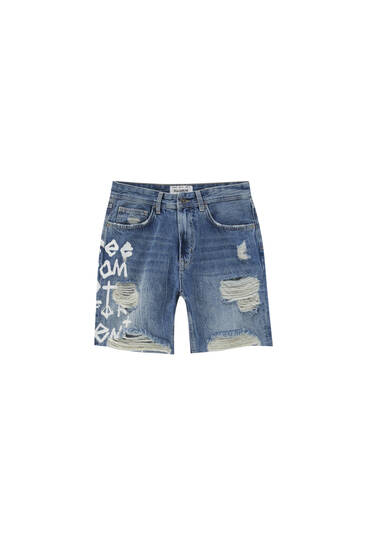Ripped denim Bermuda shorts with print