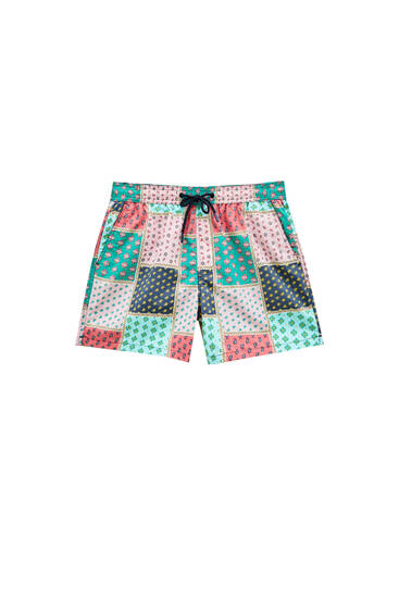Swimming trunks with all-over panel design
