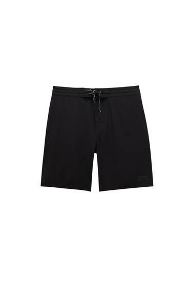 Plain-coloured surf swim shorts