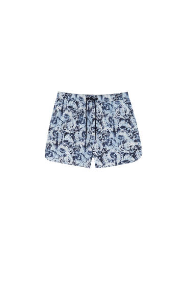 Short swimming trunks with allover print