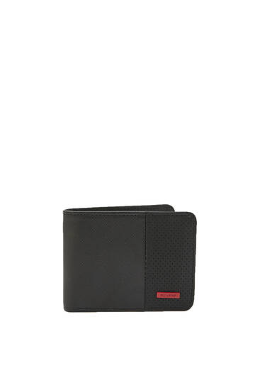 Black wallet with red tag