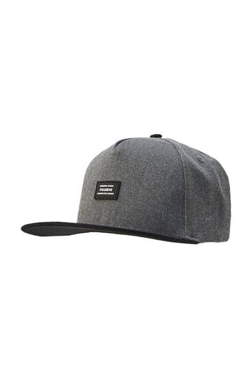 Cap with peak and rubber patch