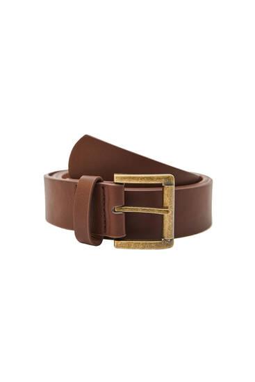 Cinturón negro hebilla dorada