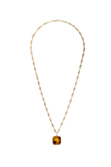 Golden necklace with tortoiseshell pendant