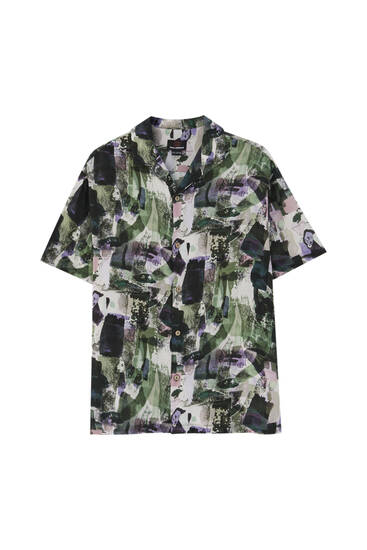 Printed shirt with green spots
