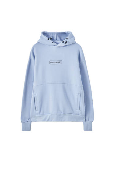Hoodie with a reflective logo