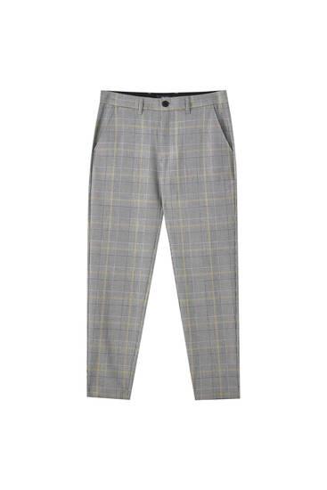 Strakke grijze broek met dambordruit