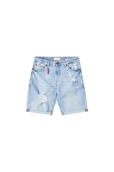 Slim fit denim bermuda met scheuren
