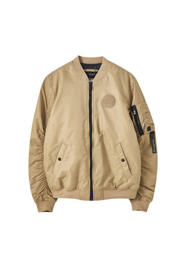 Bomber jacket with front padding