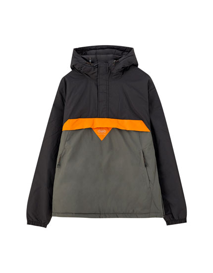 Jacket with a pouch pocket and a patch logo