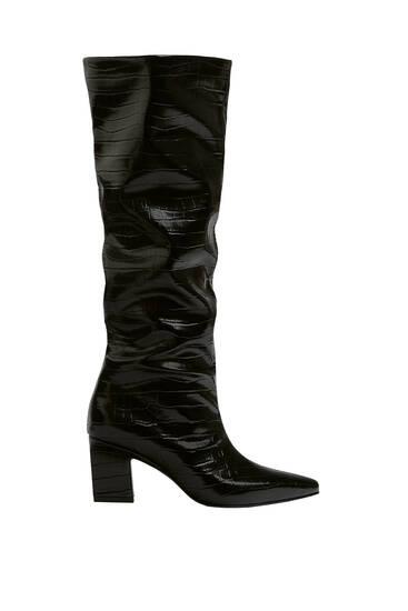 Animal print heeled knee-high boots