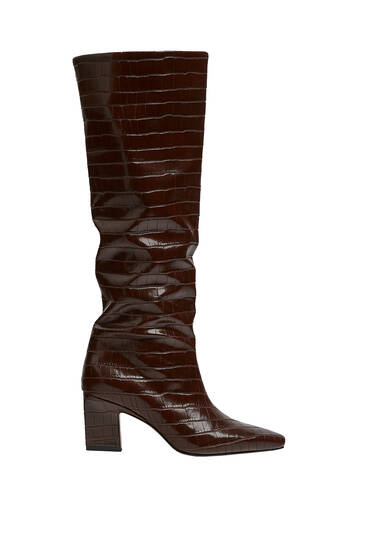 Animal print heeled knee-high boots